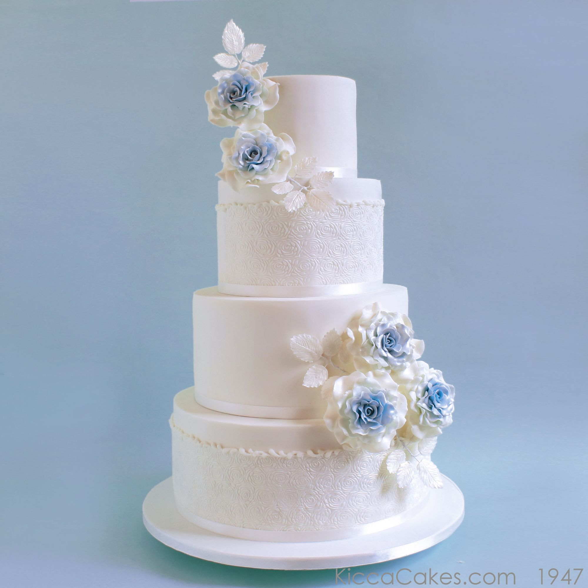4 tiers wedding cake with blue sugar flowers