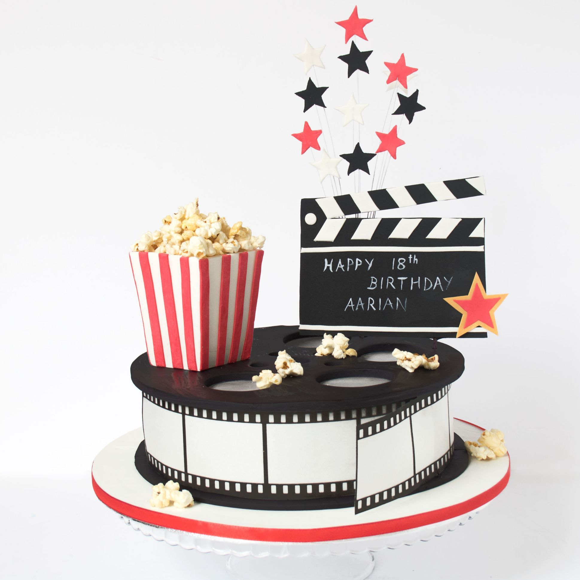 movie star cinema cake with pop corn box and clapper