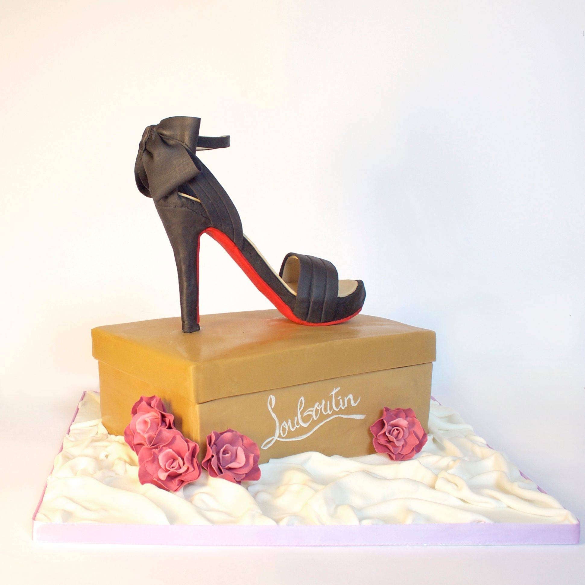 louboutin shoe model handmade in sugar on a shoe box illusion cake