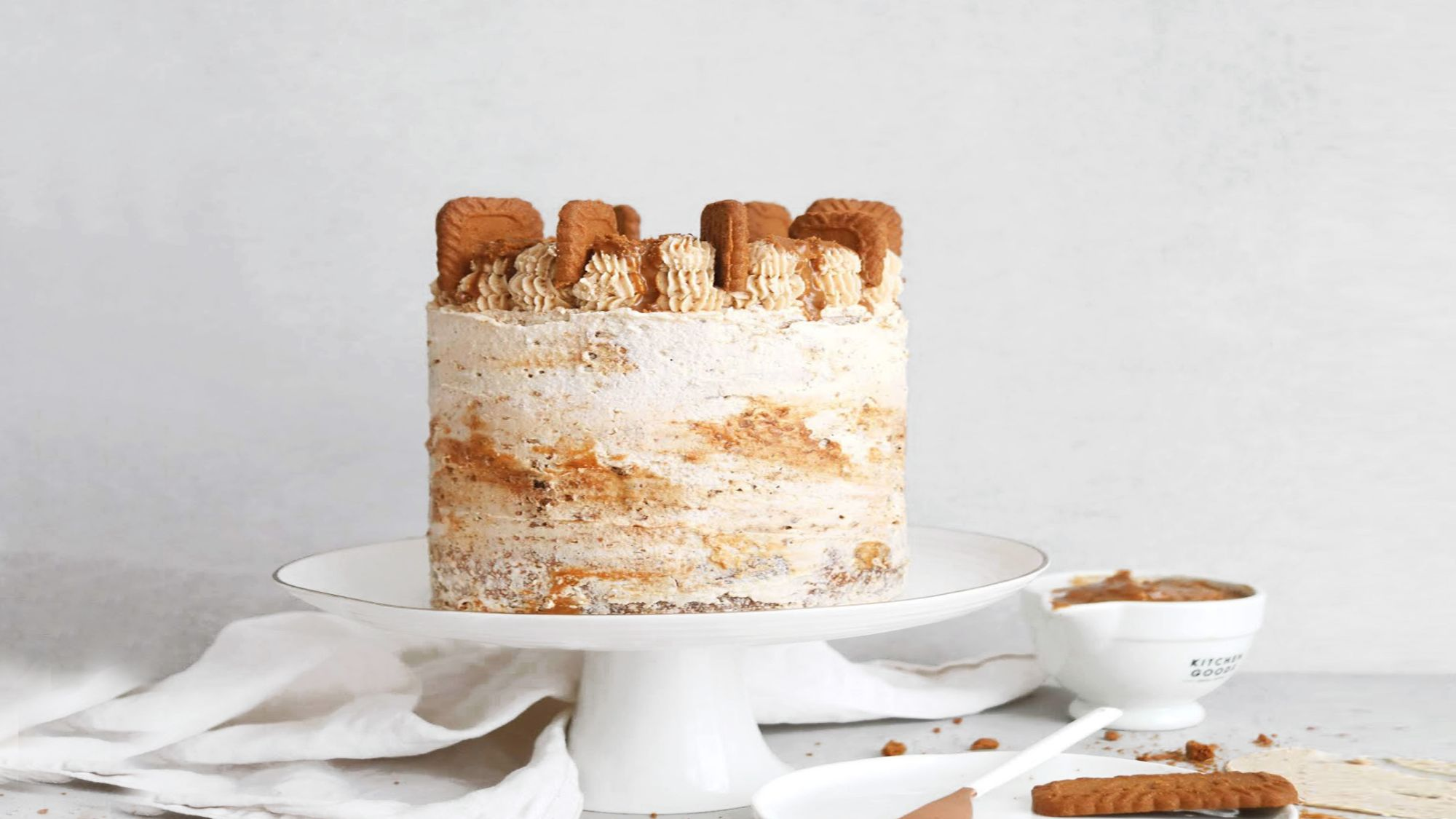 Biscoff Cake with simple piped decorations and cookies