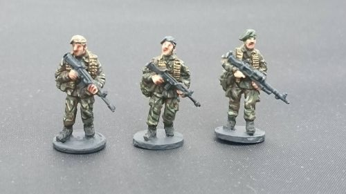 BAOR30 British Army in berets GPMG and SLR patrol poses