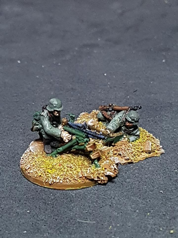 M36-06 German Infantry in M36 with MMG tripod firing