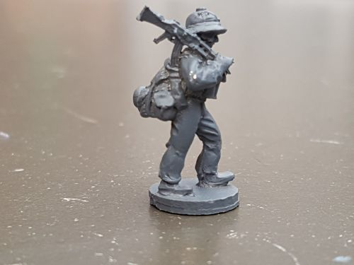LTD28 Vietnam North Vietnam Army regular with heavy pack and AK47 on should