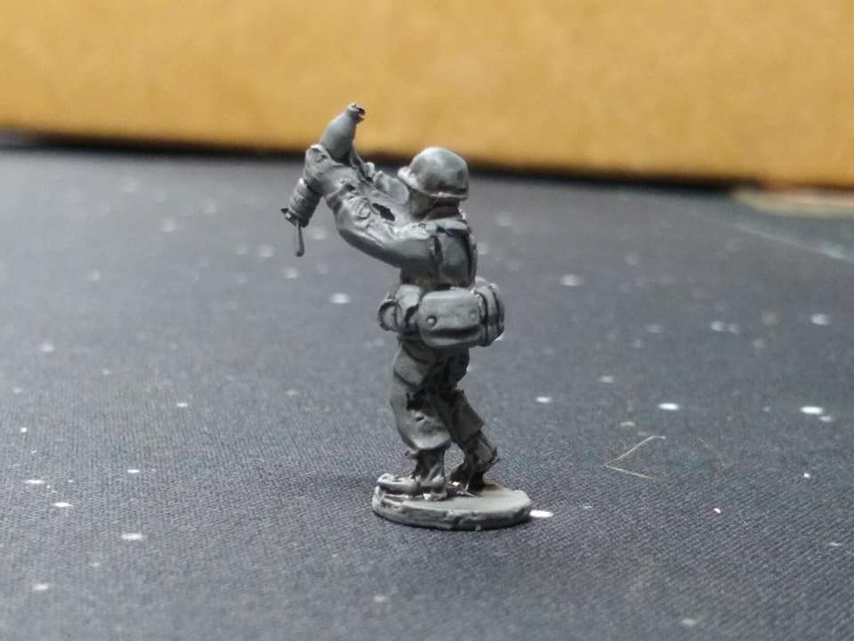NAT12 NATO 120mm Mortar crewman loading the tube (note miscast arms)