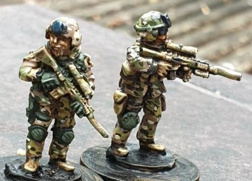 SF22 SF Snipers in plate carriers and SF MICH helmets with DMR