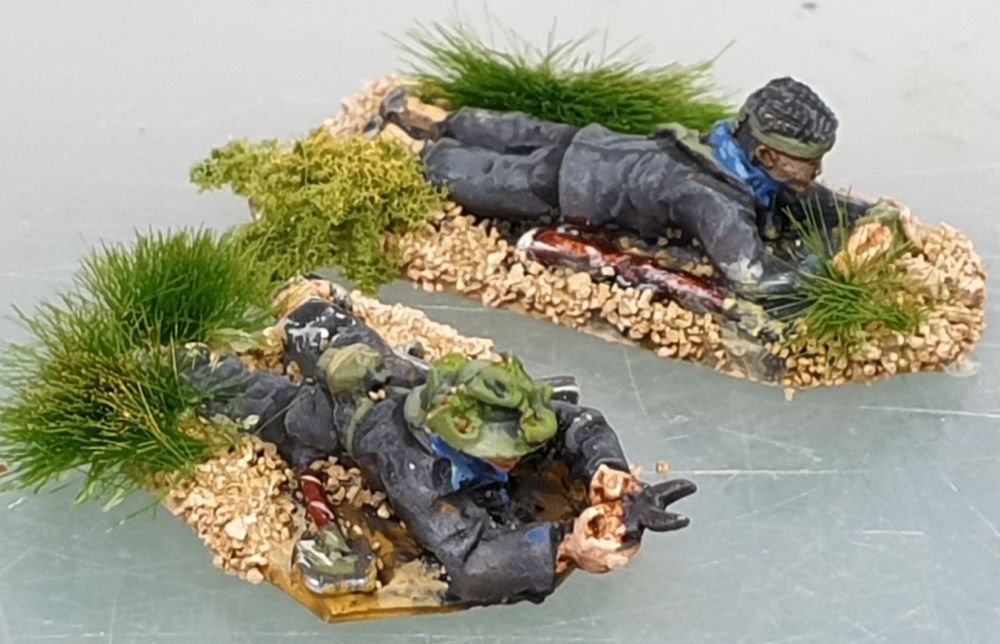 VC17 Viet Cong sappers prone. One cutting wire, one with a Claymore mine,