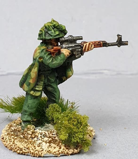 NVA18 North Vietnam Army Sniper with SVD firing in Camouflage Cape