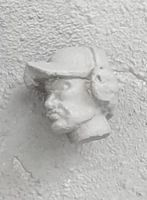 HED96 Swedish baseball cap (strong V shape on peak) with ear defenders.