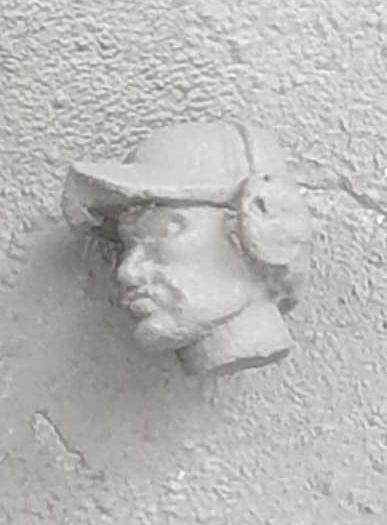 HED95 Swedish baseball cap (strong V shape on peak) with ear defenders.