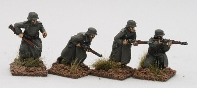 GMT01 riflemen advancing in rubberised coats