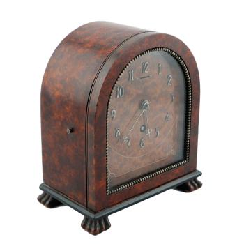 Art Deco amboyna timepiece.