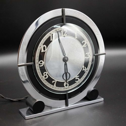 A good Art Deco chrome and bakelite electric clock by Temco.