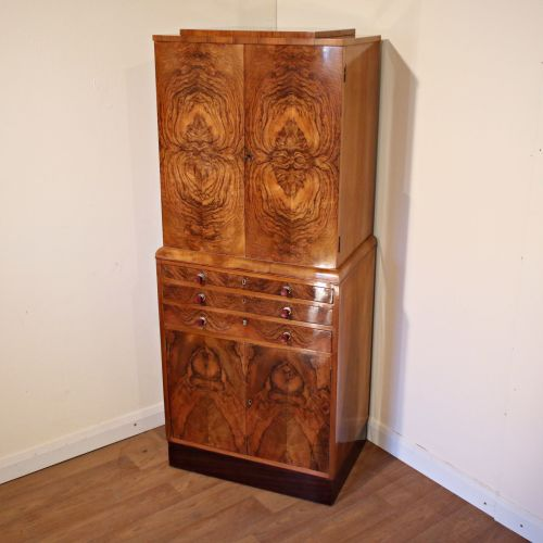Good Art Deco figured walnut cocktail cabinet with original handles
