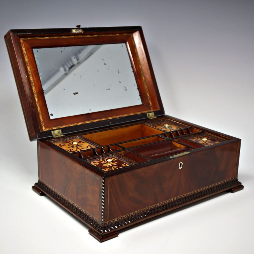 Antique flame mahogany sewing / jewellery box.