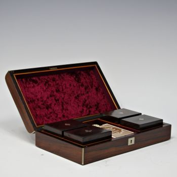 Rosewood and white metal inlaid games box.