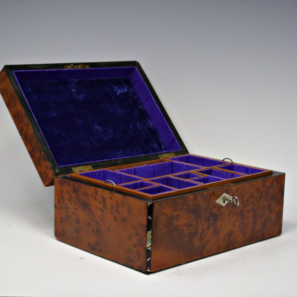 Antique amboyna and inlaid jewellery box.