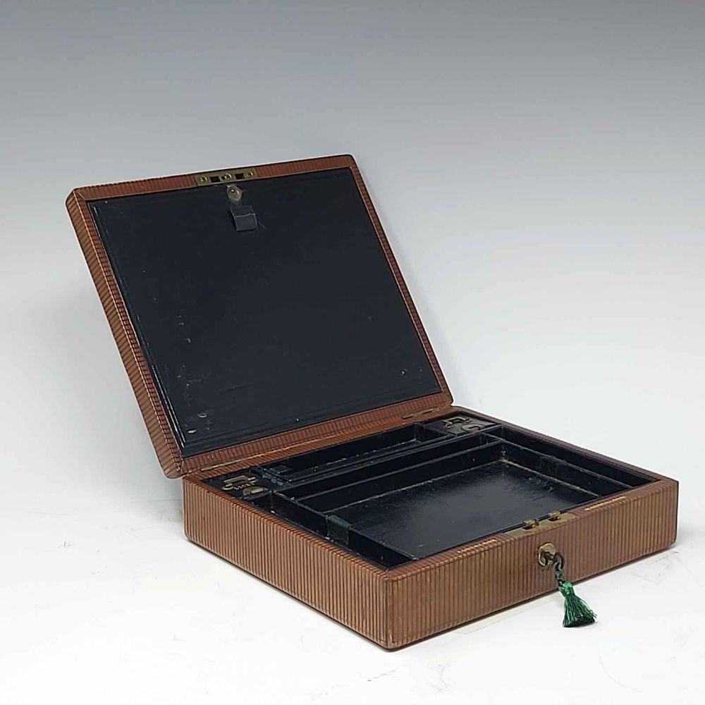 Antique leather jewellery box by Leuchars