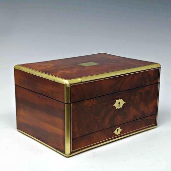 Antique flame mahogany jewellery box.