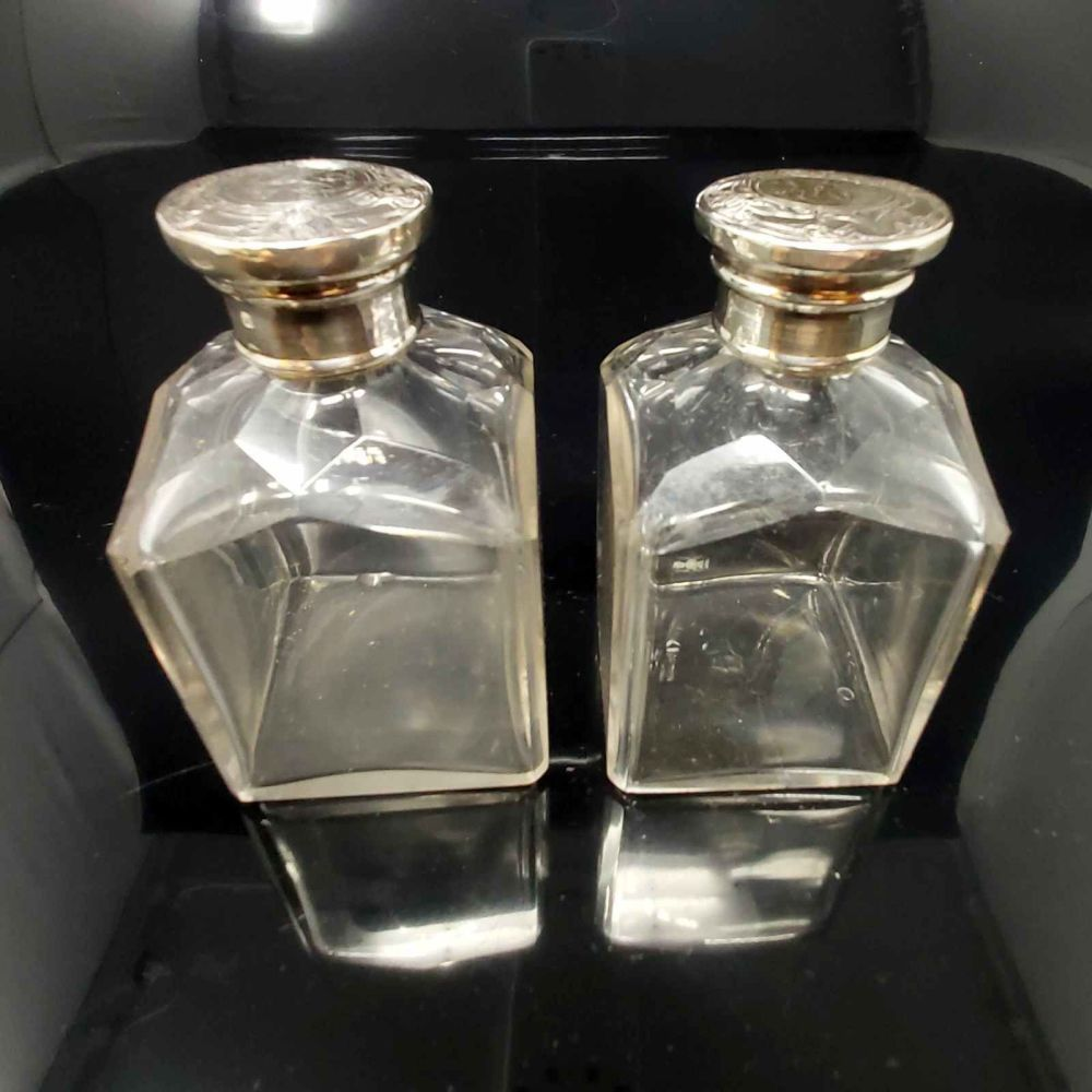 Pair of  antique sterling silver dressing table bottles.