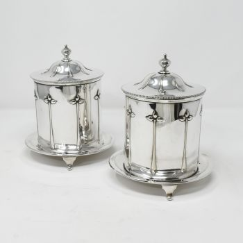 Fine pair of Art Nouveau silver plated biscuit boxes.