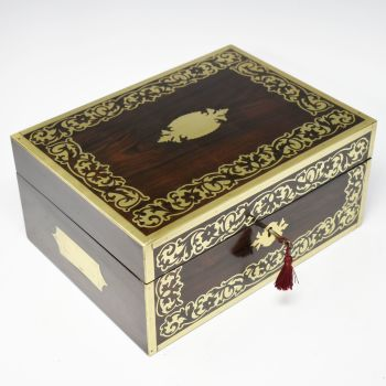 Antique rosewood and brass inlaid jewellery box.