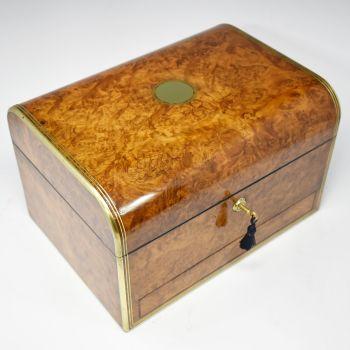 Fine antique burr walnut jewellery box by Parkins & Gotto.