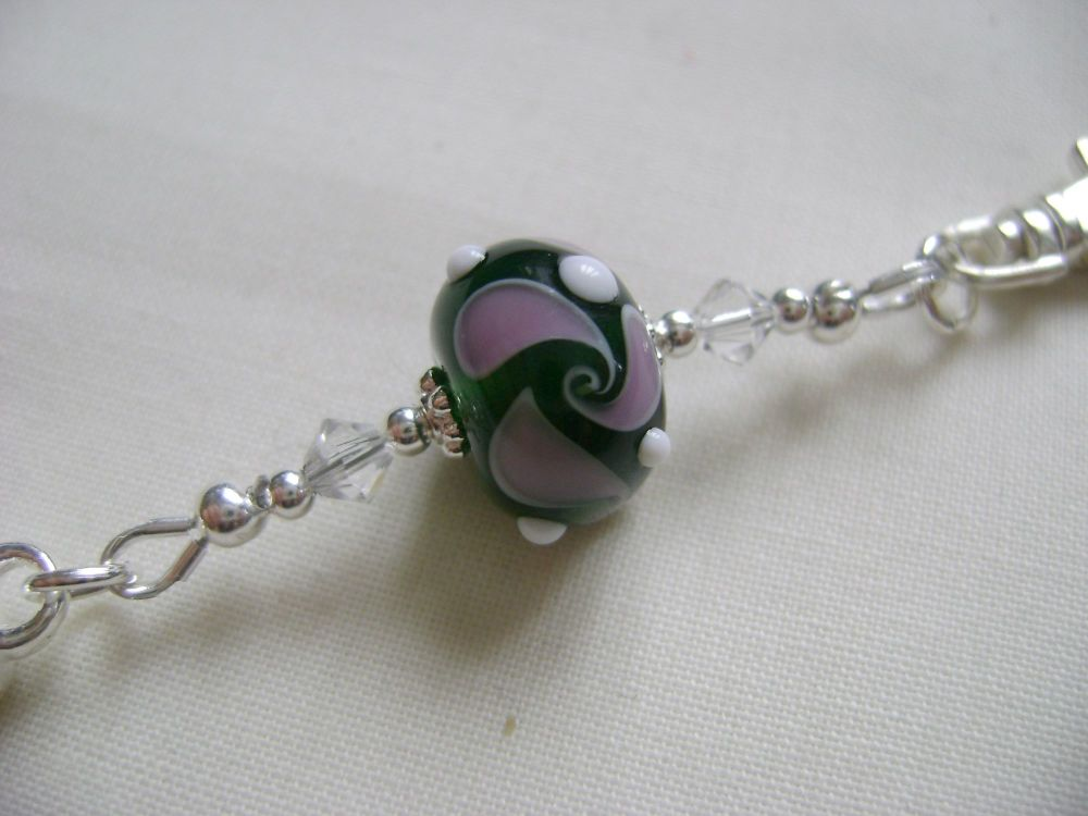 <!-- 004 -->Purple Swirl Stitch Marker Holder