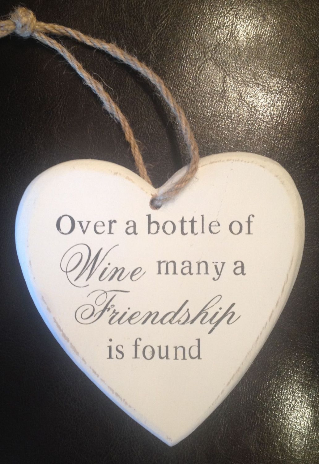 Plaque - Over a bottle of wine, many a friendship is found