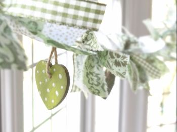 Zingy greens hand-painted solid wooden heart and fabric garland