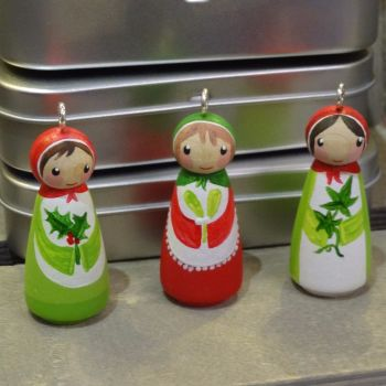 Holly, Ivy and Mistletoe peg doll Christmas ornaments in a cute gift tin