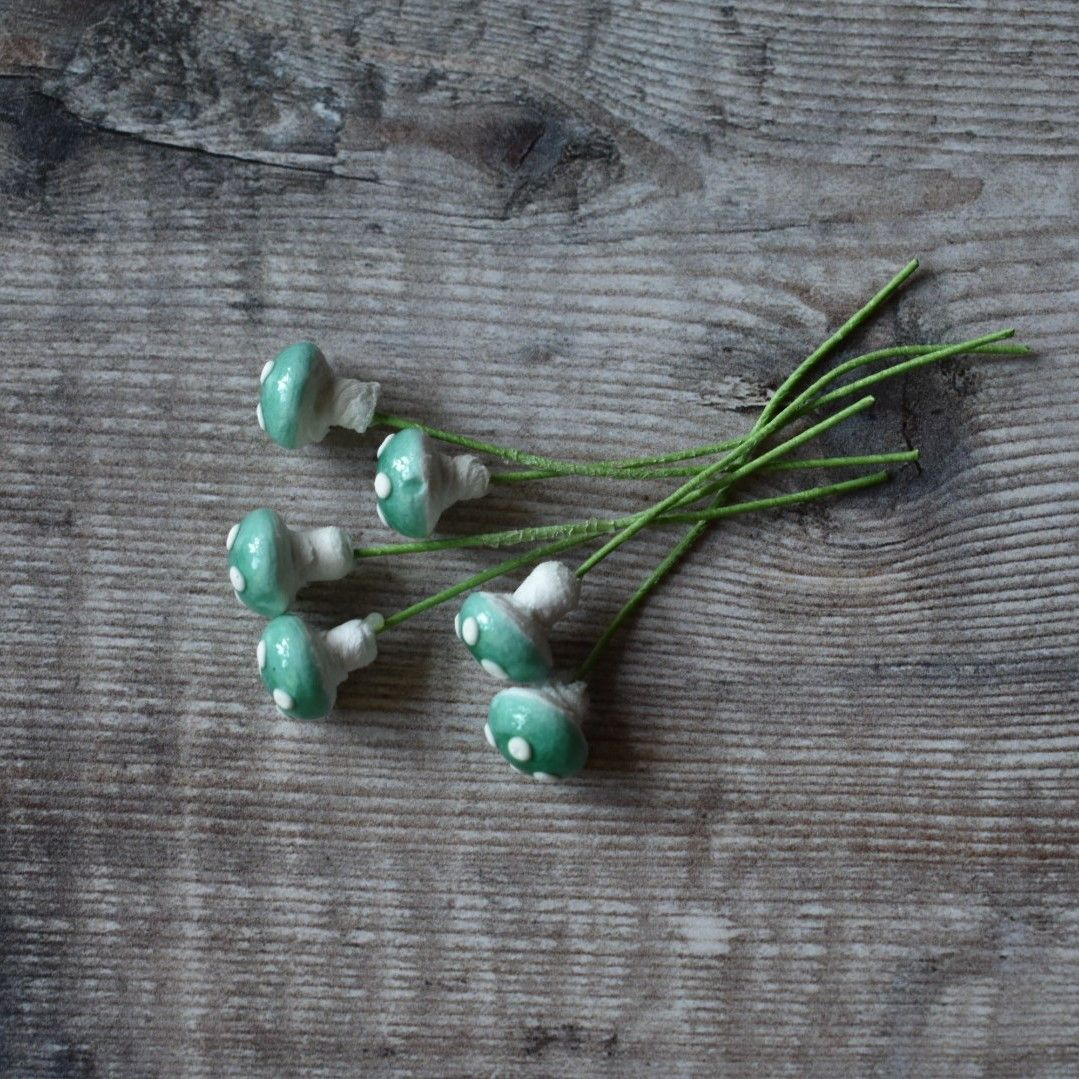 Tiny glazed spun cotton mushrooms, blue with white spots - pack of ten