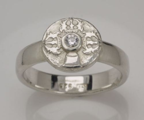 Vajra and bell disc ring