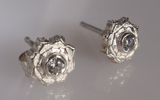 Small silver lotus stud earrings
