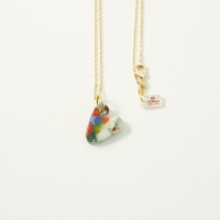 Multicoloured glass heart on gold