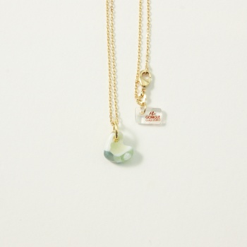 Pastel glass heart on gold