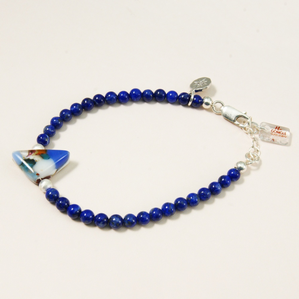 Lapis Lazuli gemstone bracelet with fused glass and a silver starburst