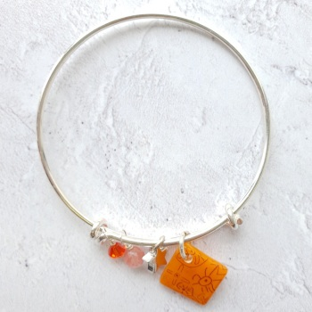 Orange neo bangle on silver