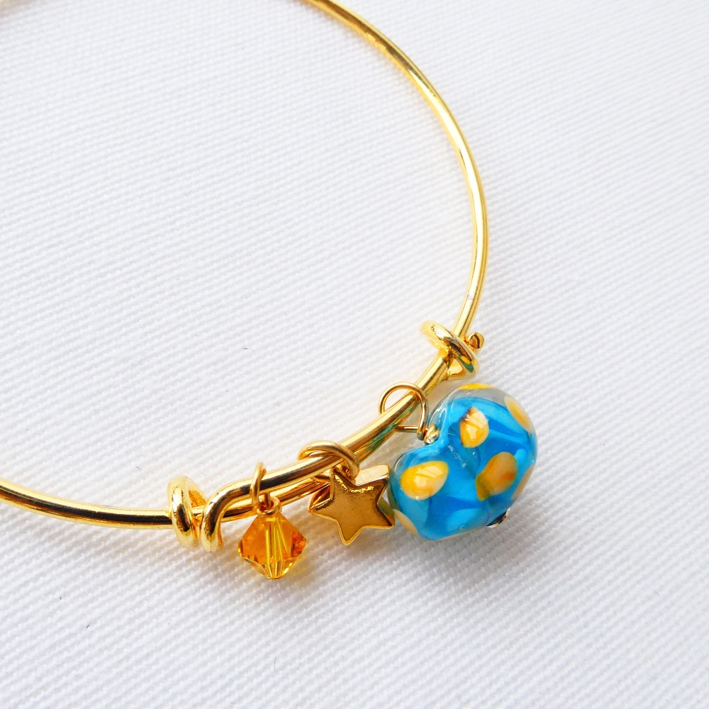 Blue and yellow  glass Heart On a 14K Gold Plated Bangle