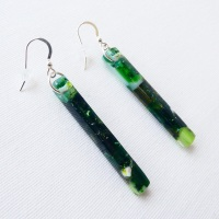Emerald glass pillar earrings on silver