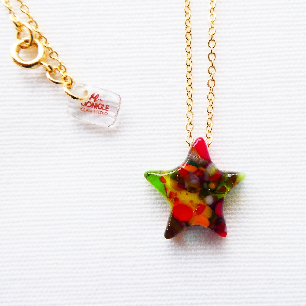 Gold shooting star in multicolours