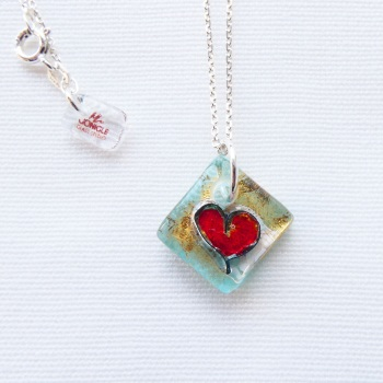 Small fused heart in Turquoise on an 18 inch solid sterling silver chain.