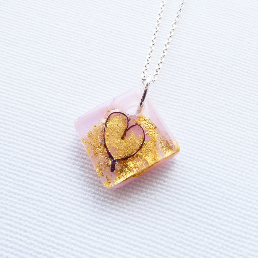 Small fused heart in pink glass on an 18 inch solid sterling silver chain.