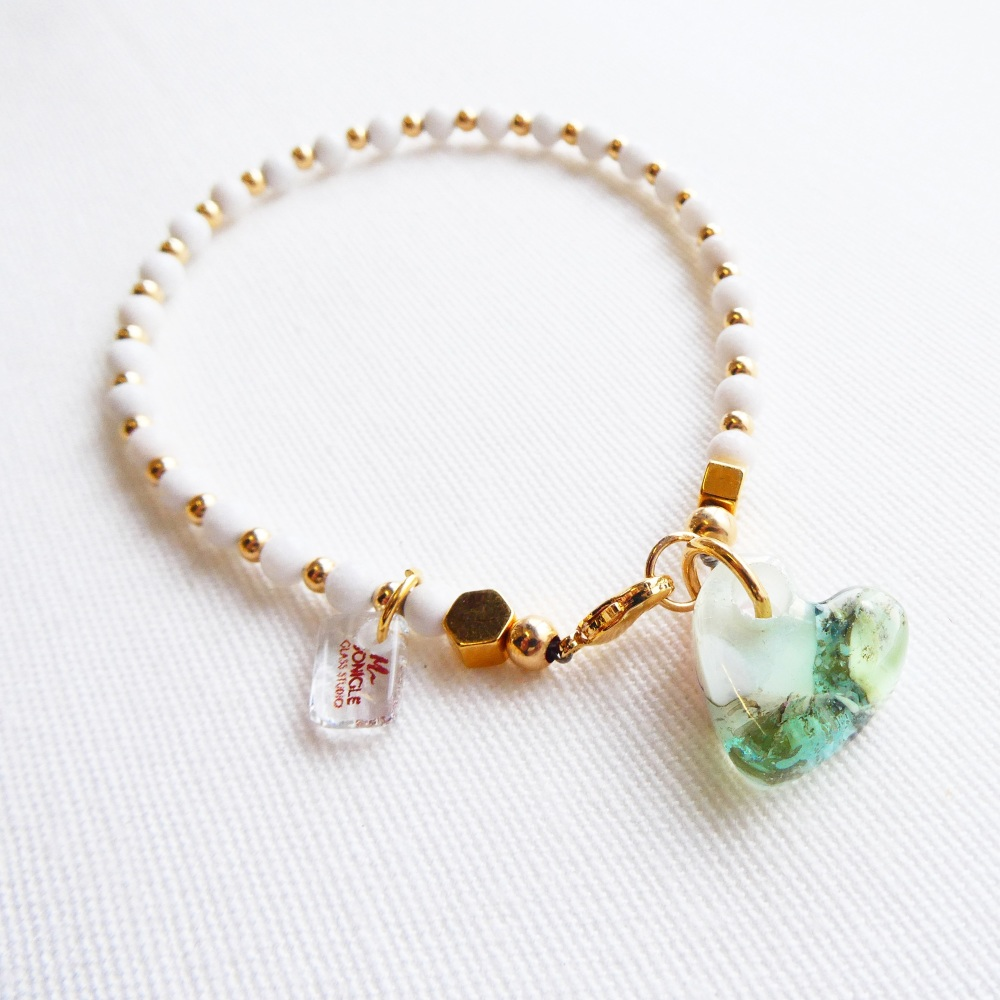 Handcarved glass heart bracelet with mountain jade gemstones and gold fille