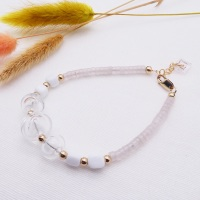 Clear bauble bead Bracelet with rose quartz gemstones.