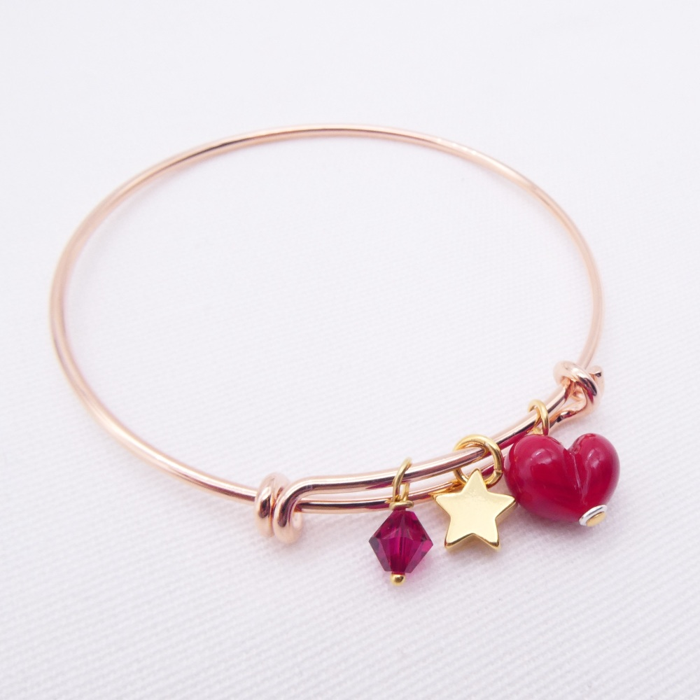 Red glass Heart On a rose gold Plated Bangle