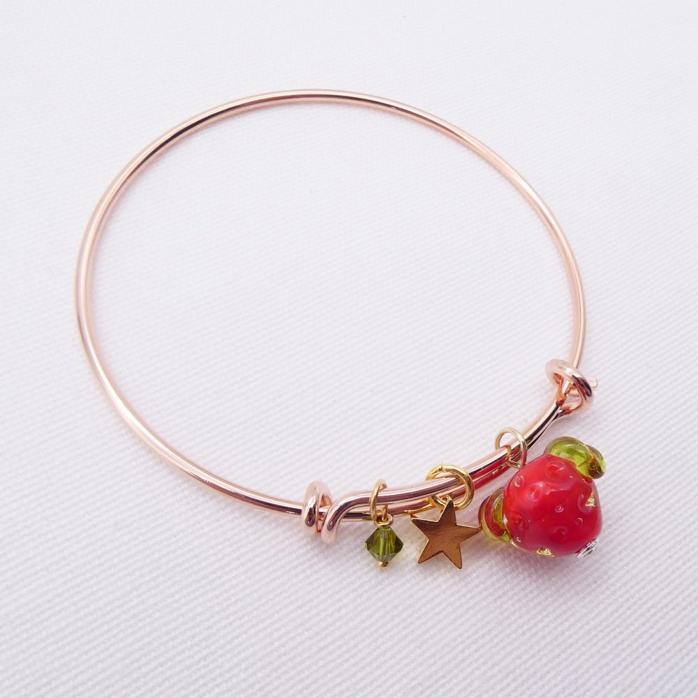 Glass strawberry On a rose gold Plated Bangle