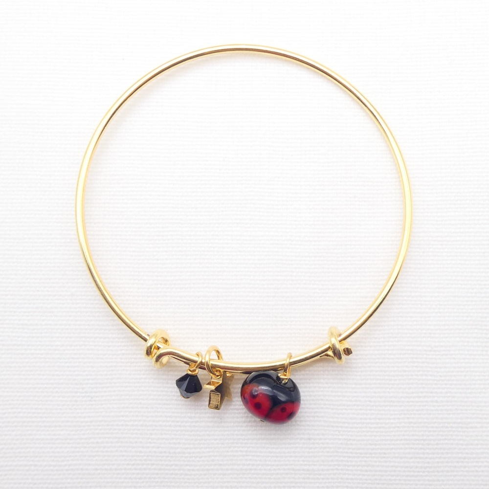 Glass Ladybird On a 14K Gold Plated Bangle