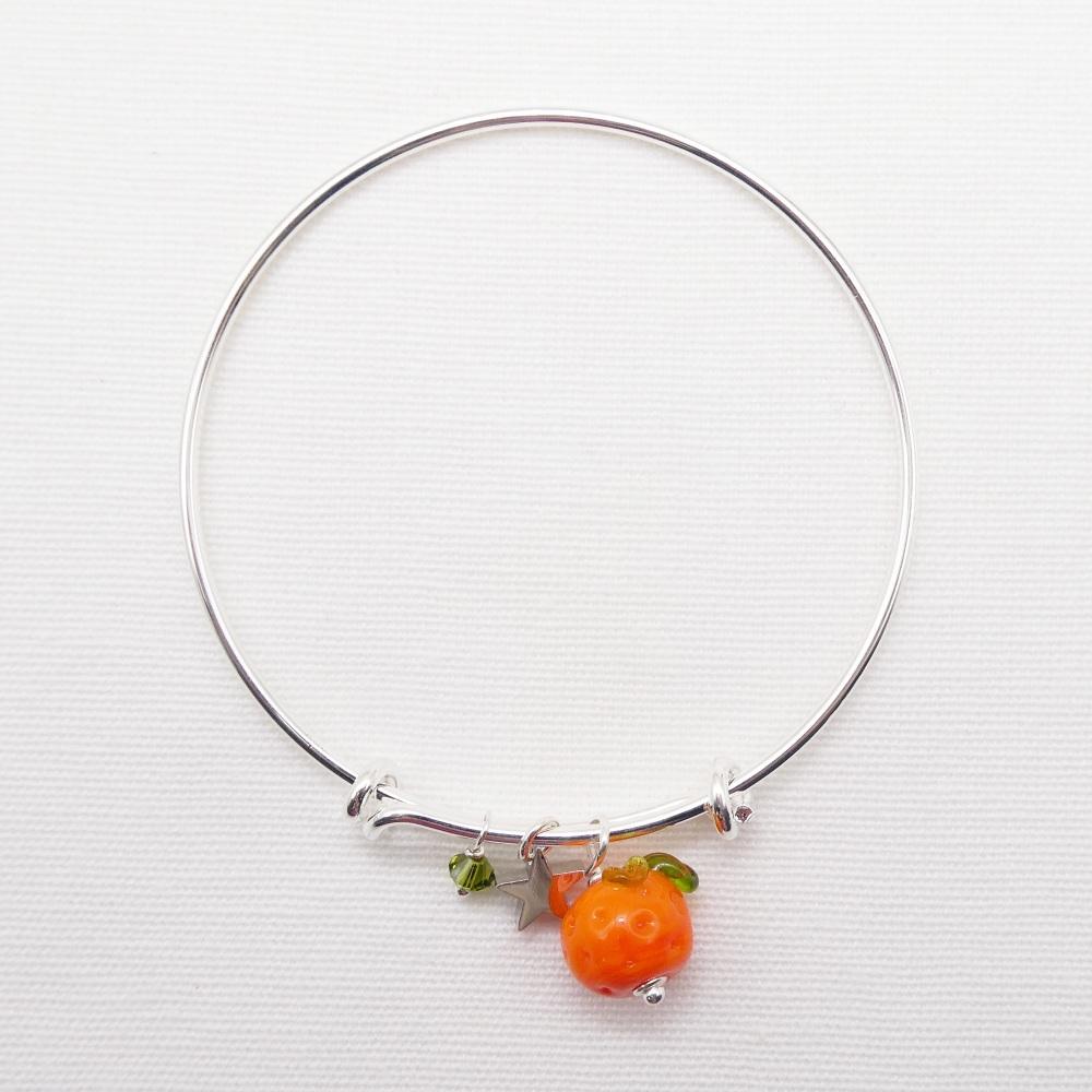 Glass orange  On a silver Plated Bangle