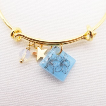 Blue floral drawing Glass Tile  On a 14K Gold Plated Bangle