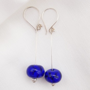 Royal Blue hot-formed glass bead on Sterling Silver.
